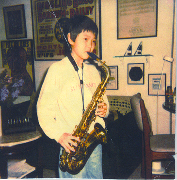 Son Ben practicing on my King alto sax